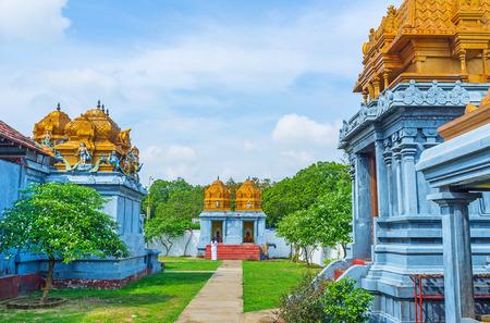 dome of hindu temple: The walk in garden of Sri Kadhiresan Kovil Hindu Temple, Anuradhapura, Sri Lanka. Stock Photo