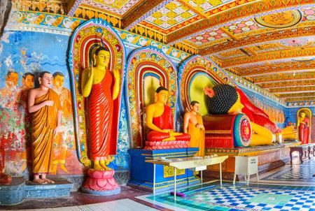 ANURADHAPURA, SRI LANKA - NOVEMBER 26, 2016: The statue of Standing Buddha, offering protection, Seated Buddha - meditating and Reclining Buddha statue - the pose of Nirvana, Isurumuniya Rock Temple, on November 11 in Anuradhapura. Editorial