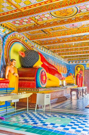 temple tank: ANURADHAPURA, SRI LANKA - NOVEMBER 26, 2016: Interior of Isurumuniya Rock Temple with Buddhist statues and colorful traceries on ceiling, on November 11 in Anuradhapura. Editorial