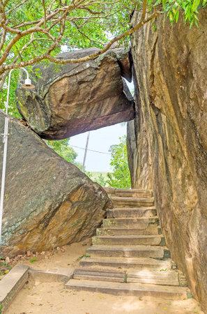 The staircase leads to the climb on the Rock of Isurumuniya Temple, Anuradhapura, Sri Lanka.