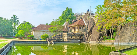 temple tank: Panorama of Isurumuniya Viharaya with the view on Rock Temple at the bank of the pond, Anuradhapura, Sri Lanka.