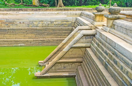 temple tank: The Kuttam Pokuna (Twin Pools) are fine example of the ancient Sinhalese architecture in Anuradhapura, Sri Lanka.