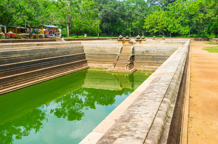 temple tank: The site of Twin Pools located in lush garden and its one of the most quiet places in Sacred City to relax in shade and enjoy the place, Anuradhapura, Sri Lanka.