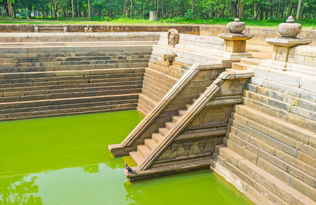 The scenic Twin Pools, located in shady garden, is the best place to relax and discover ancient architecture, Anuradhapura, Sri Lanka. Stock Photo