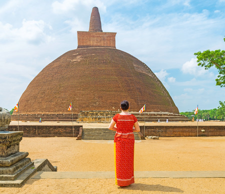 archaeological sites: The tourist watches the giant Abhayagiri Stupa, one of the famous archaeological sites and functioning monastic complex, Anuradhapura, Sri Lanka.
