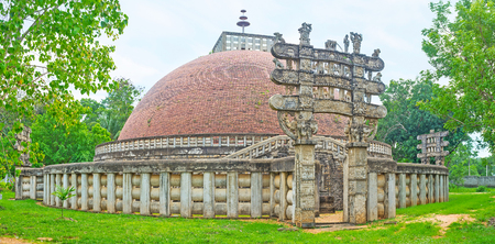 The replica of the Great Indian Sanchi Stupa with its famous Torana Gates, decorated with sculptures and reliefs, Mihintale, Sri Lanka.