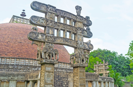 The Torana Gate of Stupa in Mihintale  (replica of Great Sanchi Stupa in India) decorated with figures of elephants, holding the vertical beams, Sri Lanka.
