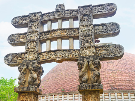 The dwarves hold the beams of Torana Gate of Stupa in Mihintale, that is the replica of Great Sanchi Stupa, Sri Lanka. Editorial