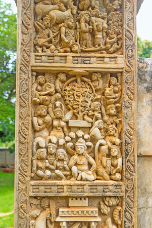toran: The Torana Gate of Great Sanchi Stupas replica in Mihintale decorated with panel, depicting Bodhi Tree and Naga-Raja Goddess with five cobras above the head, Sri Lanka.