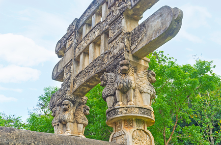 The Torana Gate of Mihintale replica of Great Sanchi Stupa decorated with lions, sitting under the beams of gateway and holding them, Sri Lanka. Editorial