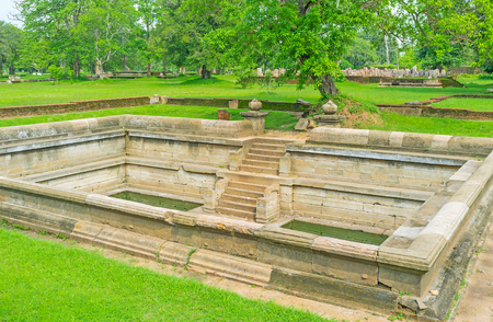 The stone pool of Jetavana Vihara - large monastic complex, nowadays serving as archaeological museum and Buddhist veneration place, Anuradhapura, Sri Lanka. Stock Photo