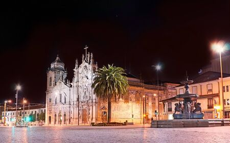 The view from the Gomes Teixeira Square on the Lions Fountain and Carmo and Carmelite Churches, decorated with azulejo tiles, Porto, Portugal.
