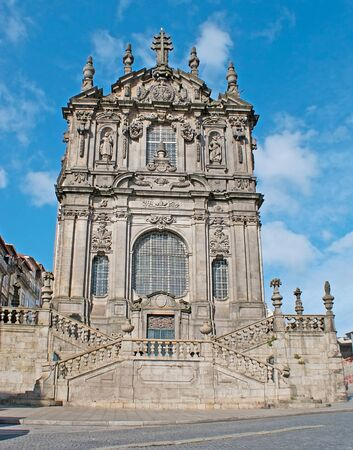 The facade of medieval Clerigos Church, decorated with stone carved patterns and sculptures of the Saints, Porto, Portugal. Stock Photo