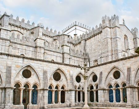 arcades: PORTO, PORTUGAL - APRIL 30, 2012: The stone cloister of the medieval Cathedral with blue azulejo panels in covered arcades, on April 30 in Porto. Editorial