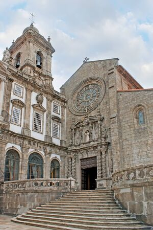 francis: The entrance to St Francis Church decorated with carved patterns, twisted pillars, sculptures with the scenic rose window above the door, Porto, Portugal.