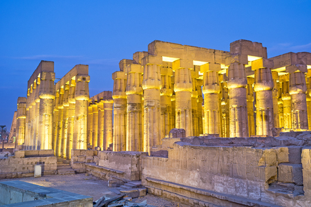 The numerous columns of the Luxor Temple in the bright evening illumination, Egypt.