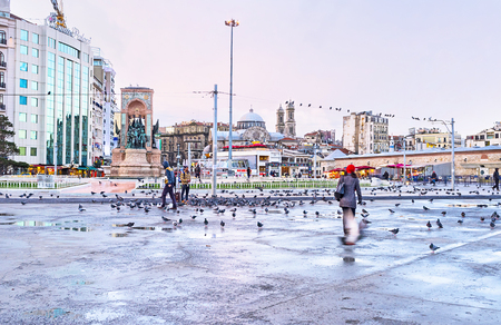 ISTANBUL, TURKEY - JANUARY 13, 2015:The ensemble of the Taksim Square with the Republic Monument in the middle, on January 13 in Istanbul.