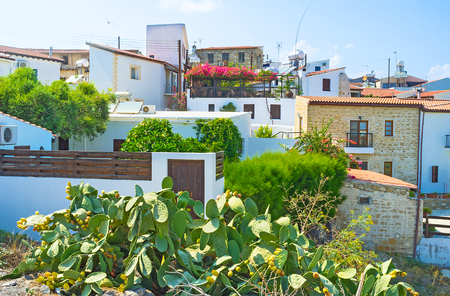 The view on the small hilly village of Maroni with the large cactus bush on the foreground, Cyprus.