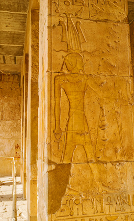 eligion: The columns in Hatshepsut Temple with the preserved reliefs and hieroglyphs, Luxor, Egypt.