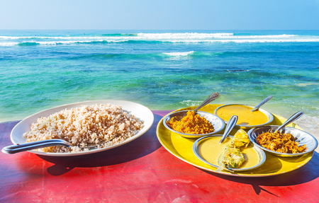 The coastal cafes of Ahangama offer delisious rice and fish curry with a view on the oceans shore, Sri Lanka.