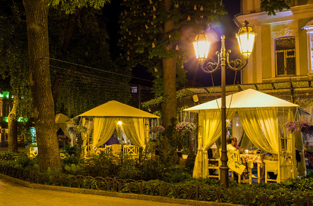 candlelit: ODESSA, UKRAINE - MAY 17, 2015: One of the most romantic places in Odessa is the restaurants pavilions in the City Garden, on May 17 in Odessa.