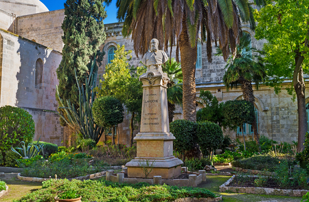 JERUSALEM, ISRAEL - FEBRUARY 16, 2016: The monument to Cardinal Lavigerie in shady garden of St Anne Church, located at the beginning of Via Dolorosa in Muslim Quarter, on February 16 in Jerusalem.