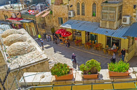 16: JERUSALEM, ISRAEL - FEBRUARY 16, 2016: The view on cozy cafes of Via Dolorosa street from the terrace of Austrian Hospice, on February 16 in Jerusalem. Editorial