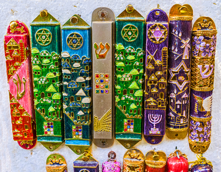 The mezuzah is affixed to the doorframe of homes in Jewish culture, also popular as the protection symbol, souvenir from Israel. Zdjęcie Seryjne - 70593384