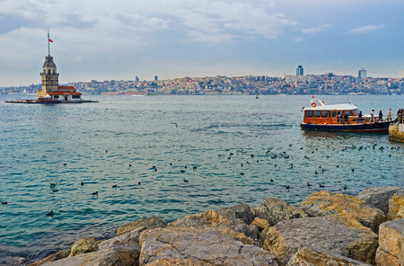 The Boshorus embankment with the view on the Maidens Tower, popular tourist attraction next to the Asian shore ofIstanbul, Turkey.