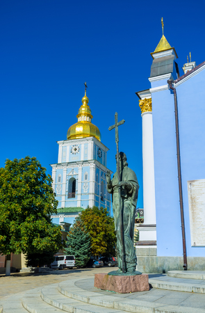 The statue of St Andrew the First Called with the bell tower of St Michaels Golden-Domed Monastery on the background, Kiev, Ukraine. Stock Photo