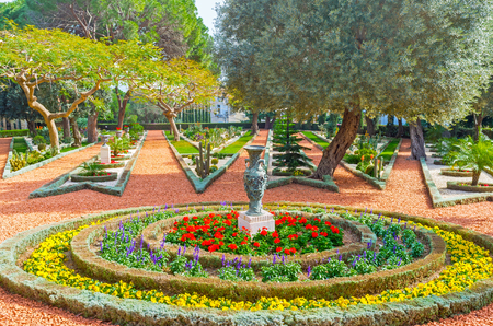 The gravel paths diverge like the rays of a star, separated with the colorful flower beds, Bahai Gardens, Haifa, Israel. Stock Photo