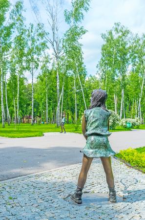 shuttlecock: The bronze sculpture of boy and girl, playing tennis in the Sculpture Garden of Gorky Park of Kharkov, Ukraine.