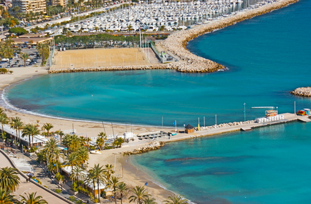 menton: Aerial view of the coast with the cozy beach, promenade with palms and large yacht port, Menton, France.
