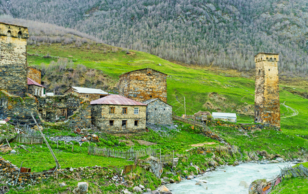 The old houses and towers of highlanders are built of the local stone and preserved since the Middle Ages, Ushguli, Upper Svaneti, Georgia. Stock Photo