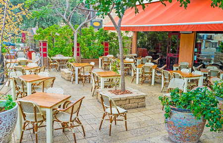 The German Colony neighborhood is full of nice cafes and restaurants, offering the national cuisine, Haifa, Israel. Stock Photo