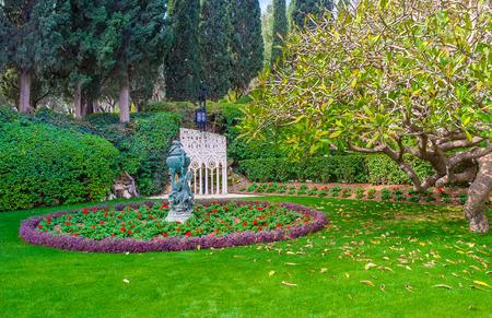 The lazy walk among the beauty of Bahai Gardens, Haifa, Israel. Stock Photo