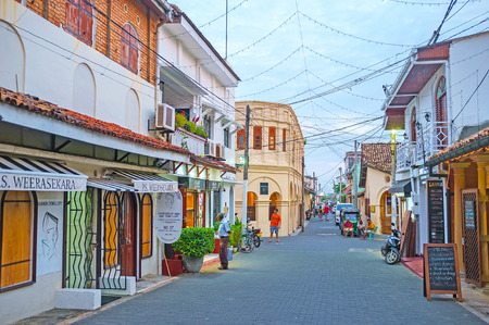 GALLE, SRI LANKA - DECEMBER 3, 2016: The best way to spend the evening in Galle Fort is to walk along its old streets and visit local cafe or restaurant, on December 3 in Galle.