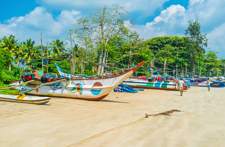 WELIGAMA, SRI LANKA - DECEMBER 3, 2016: The large catamaran boats on the sand of the local fishing harbor, on December 3 in Weligama.