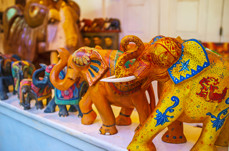 The carved wooden or stone elephants are famous souvenirs, that often are covered with different patterns and serve as the symbols of luck and nice memories of vacation in Sri Lanka, Galle.