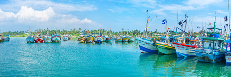 windless: MIRISSA, SRI LANKA - DECEMBER 3, 2016: The fishing boats, moored in harbor, stay quiet at windless weather, on December 3 in Mirissa.
