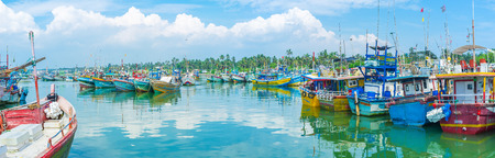 MIRISSA, SRI LANKA - DECEMBER 3, 2016: The fisheries harbor occupied with boats, ships, catamarans and trawlers of local fishermen, on December 3 in Mirissa.