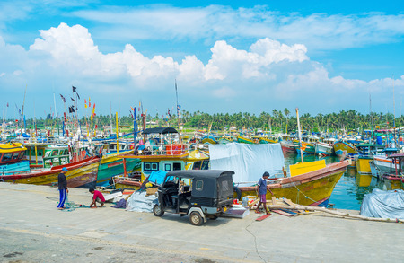 MIRISSA, SRI LANKA - DECEMBER 3, 2016: The fishing port located next to the resorts of the South Coast, tourists often visit it, on December 3 in Mirissa. Editorial