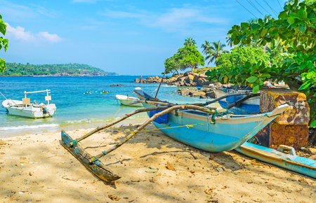 The old catamaran boat at the sandy beach of the Dondra Head Cape - extreme southern tip of Sri Lanka.