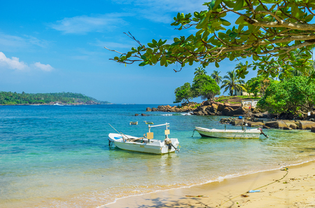 The motor boats at the shore of the most southern beach of Sri Lanka, located on the Dondra Head Cape.