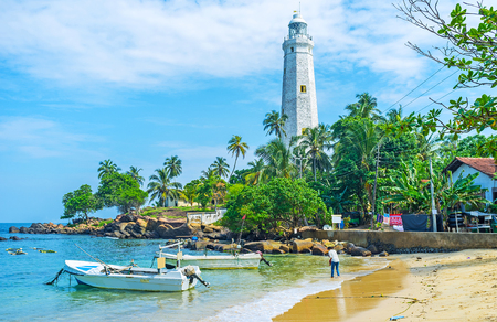 The cozy beach of Dondra boasts scenic views on the old lighthouse and greenery on the southern tip of Sri Lanka. Stock Photo