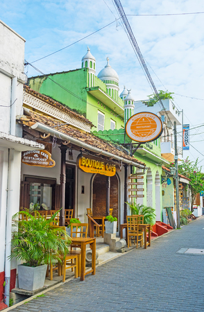 galle: GALLE, SRI LANKA - DECEMBER 3, 2016: The outdoor terrace of the small cafe in old town, located next to Jiffry Thaikkah Mosque, on December 3 in Galle.