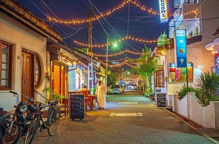 GALLE, SRI LANKA - DECEMBER 3, 2016: The old town streets are the perfect place for the evening walks, visit of local cafes and souvenir stores, enjoy the old architecture, on December 3 in Galle.