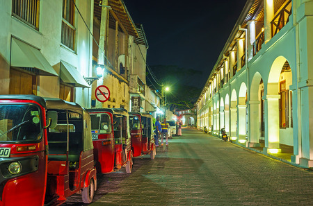 GALLE, SRI LANKA - DECEMBER 3, 2016: The tuk tuks parking at the historic building of Old Dutch Hospital, nowadays serving as hotel and luxury restaurant, on December 3 in Galle.