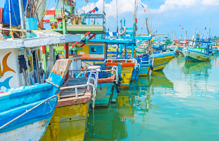 fischerei: The interesting excursion to the large fisheries harbor of Mirissa, full of colorful trawlers and catamaran boats of local fishermen, Sri Lanka. Editorial