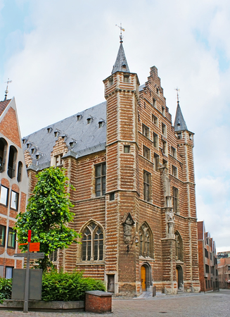 The Vleeshuis (Butchers Hall) is one of the most famous medieval buildings of the city, decorated with stepped gable, stone sculptures and towers, Antwerp, Belgium.